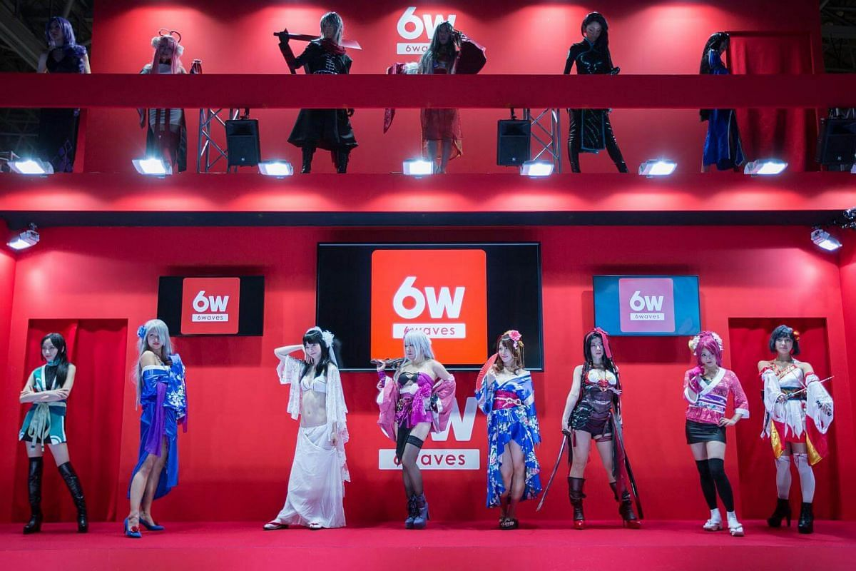 Costume players from 6W's game characters pose for visitors during the Tokyo Game Show 2017 at Makuhari Messe in Chiba, Tokyo, on Sept 21, 2017.