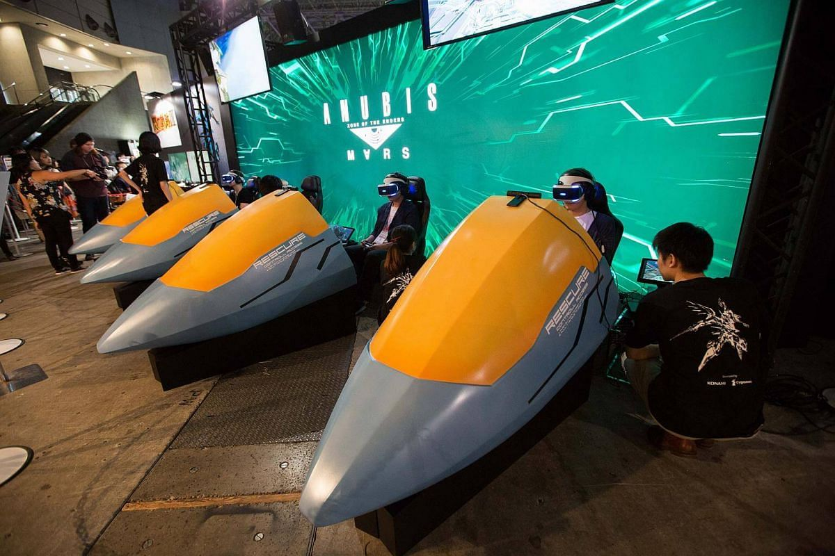 Visitors are seen experiencing a VR Zone of the Enders: Anubis Mars game during the Tokyo Game Show 2017 at Makuhari Messe in Chiba, Tokyo, on Sept 21, 2017.