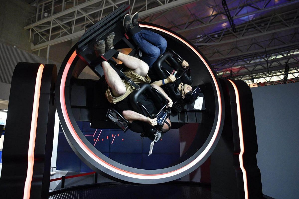 Visitors ride in the Gyro VR during the Tokyo Game Show 2017 at Makuhari Messe in Chiba, Tokyo, on Sept 21, 2017.