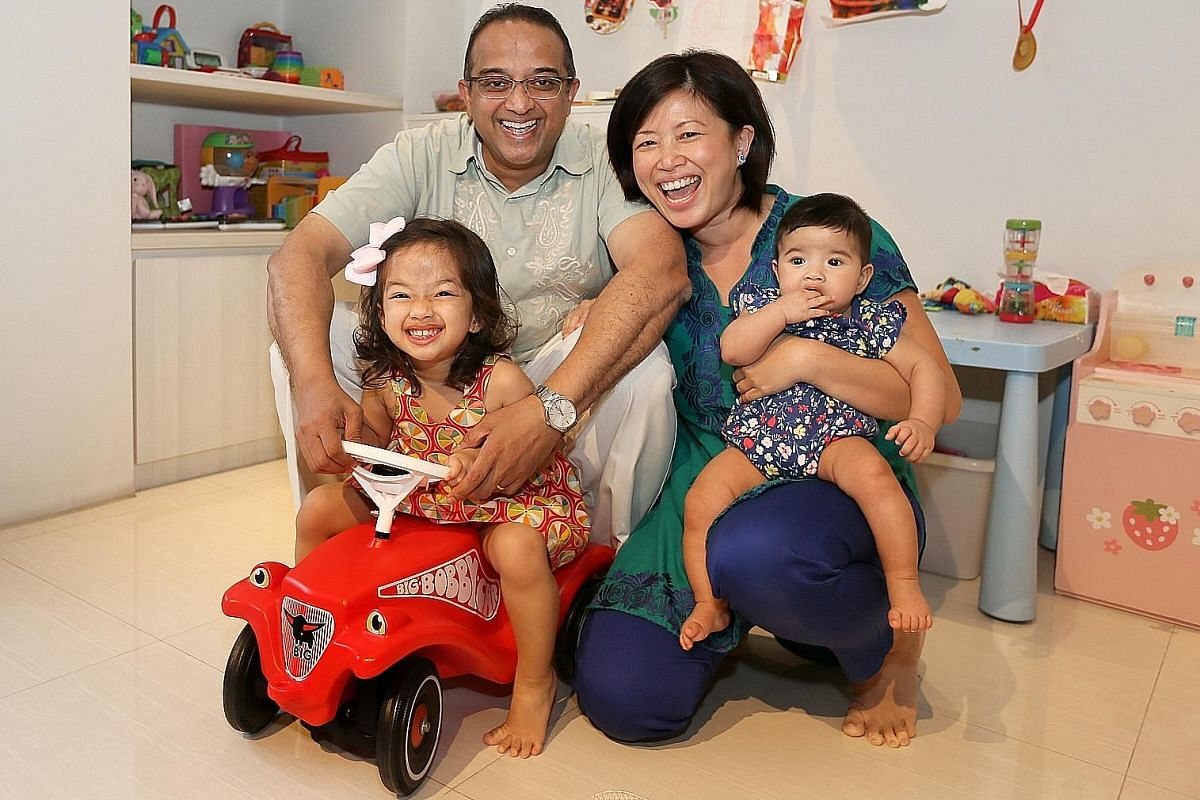 Mr Lucien Low, 54, with his wife Jocelyn Lau, 43, and their five-year-old son, Robin. Mr Vasu Menon, 53, with his wife Jean Lim, 40, and their daughters Natasha, two, and Alisha, four months.