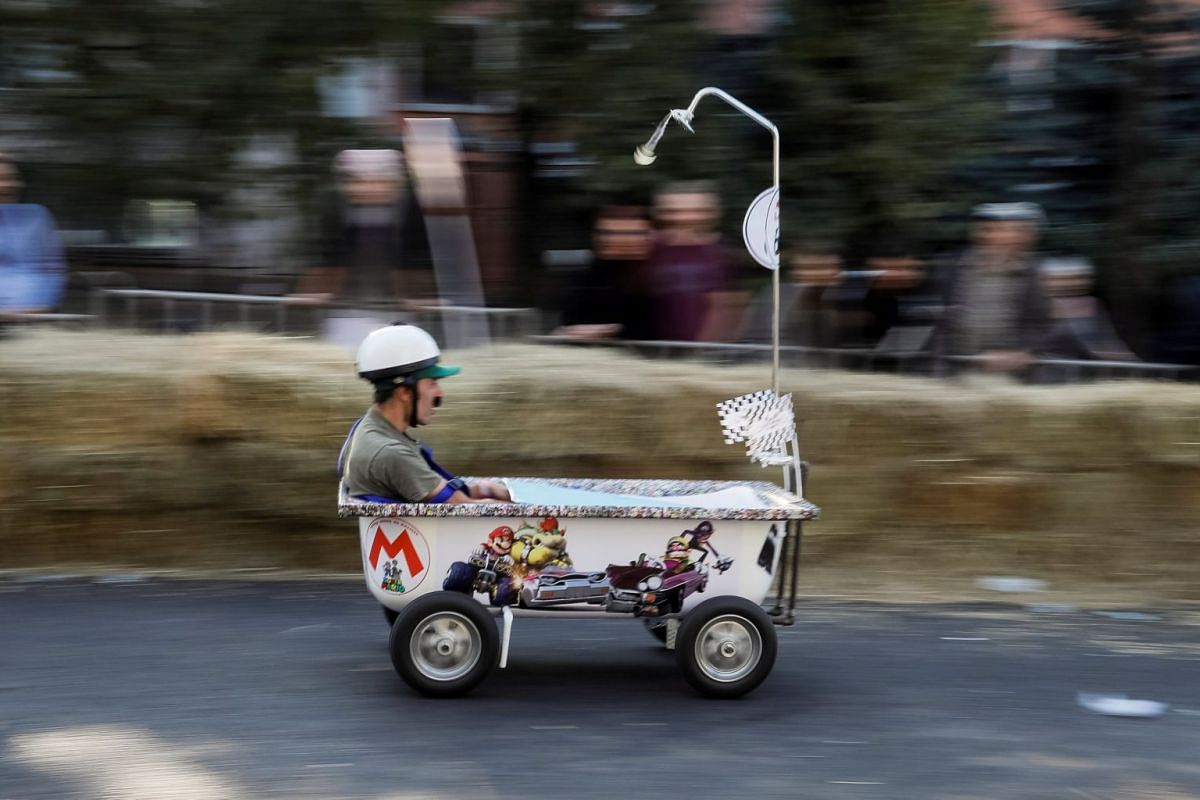 A competitor drives his homemade vehicle without an engine during the Red Bull Soapbox Race in Almaty, Kazakhstan September 24, 2017. PHOTO: REUTERS