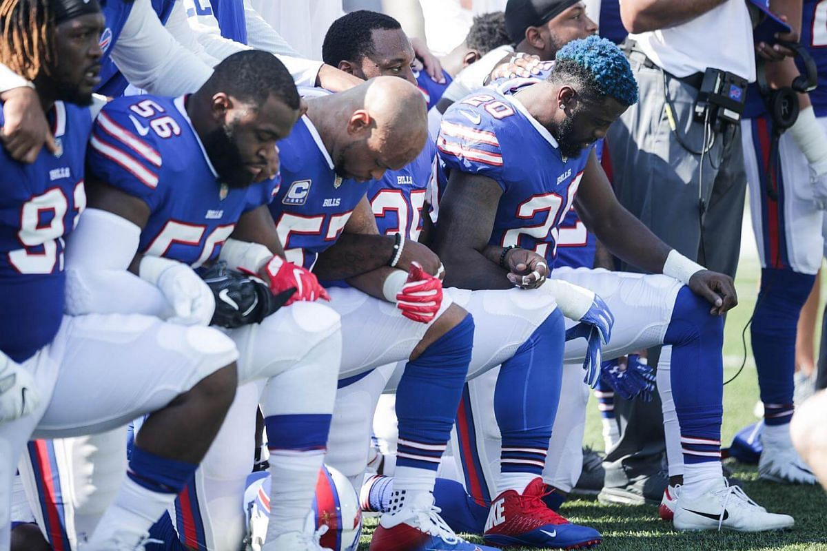 Buffalo Bills players kneel during the US national anthem before an NFL game against the Denver Broncos on Sept 24, 2017.