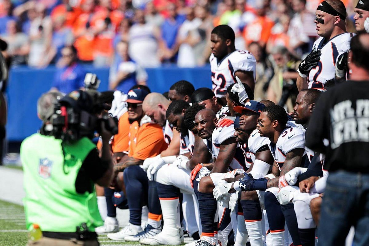 Denver Broncos players kneel during the US national anthem before an NFL game against the Buffalo Bills on Sept 24, 2017.