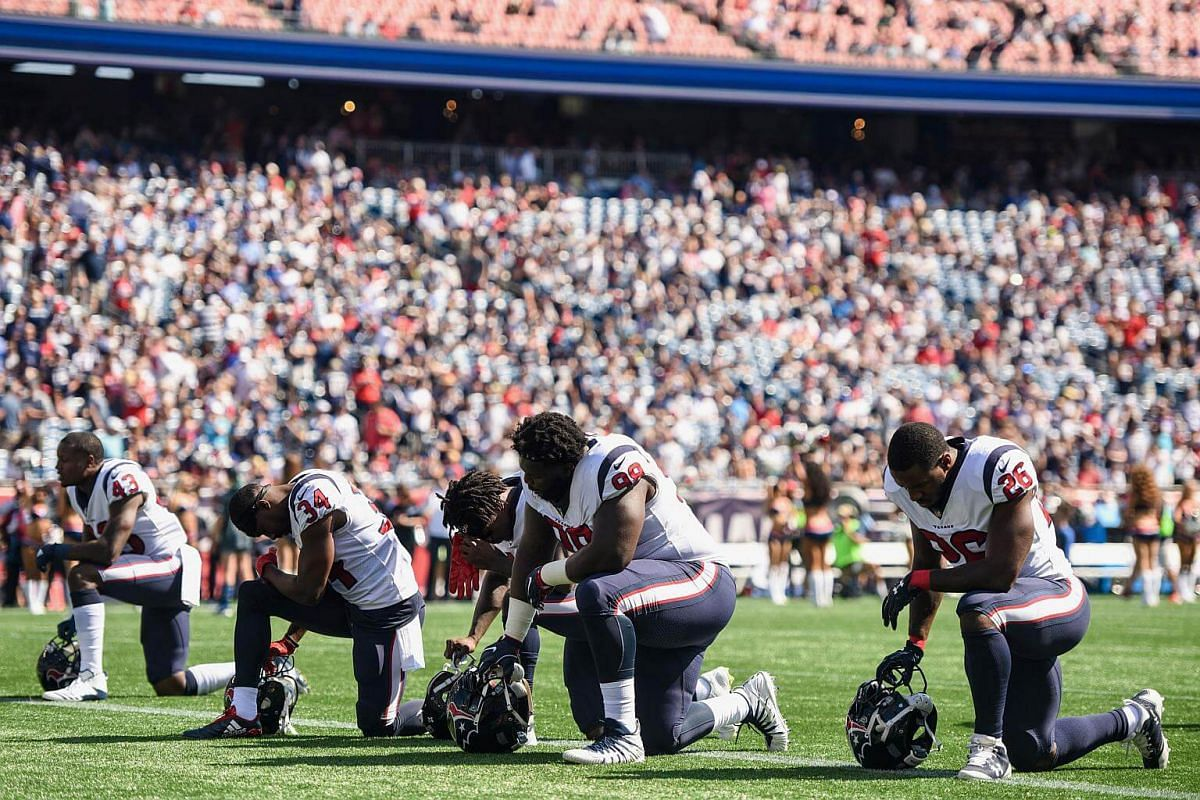 Houston Texans players kneel during the US national anthem before an NFL game against the New England Patriots on Sept 24, 2017.