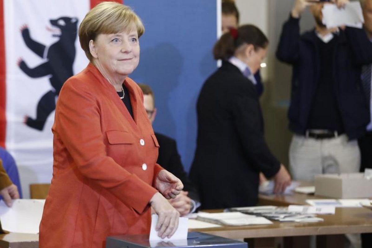 German Chancellor and CDU party leader Angela Merkel casts her vote.