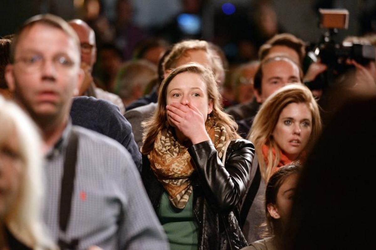 The Greens react to the first prediction of the result at the party's election event in Berlin on Sunday (Sept 24).
