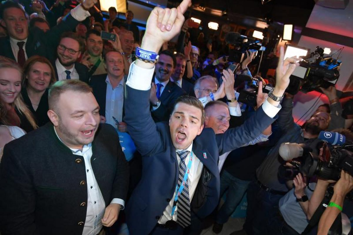 Supporters of the the German right-wing populist party Alternative for Germany (AfD), react to exit polls.