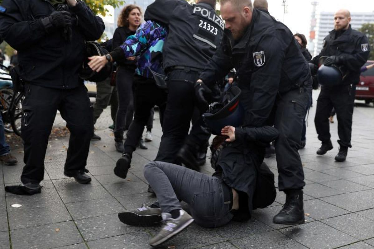 Demonstrators scuffle with police during the protest against the anti-immigration party Alternative for Germany on Sunday (Sept 24).