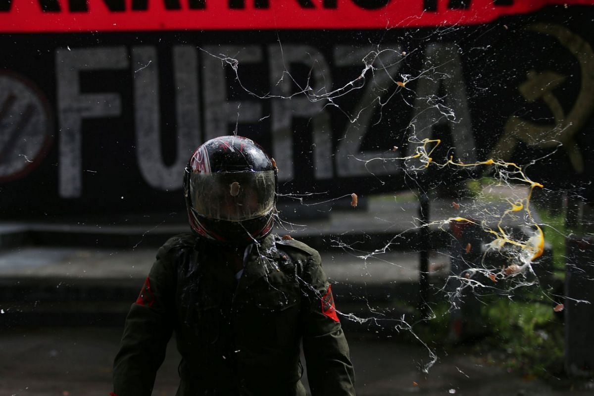 An El Salvador National University student dressed as a soldier performs during a protest against the government, which uses the military to control crime in San Salvador, El Salvador, on Sept 25, 2017. PHOTO: REUTERS