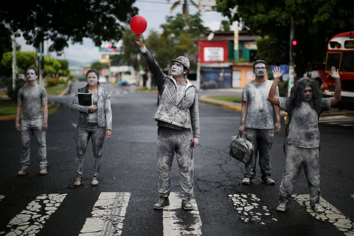 El Salvador National University students perform during a protest against government, which uses military to control crime in San Salvador, El Salvador, on Sept 25, 2017. PHOTO: REUTERS