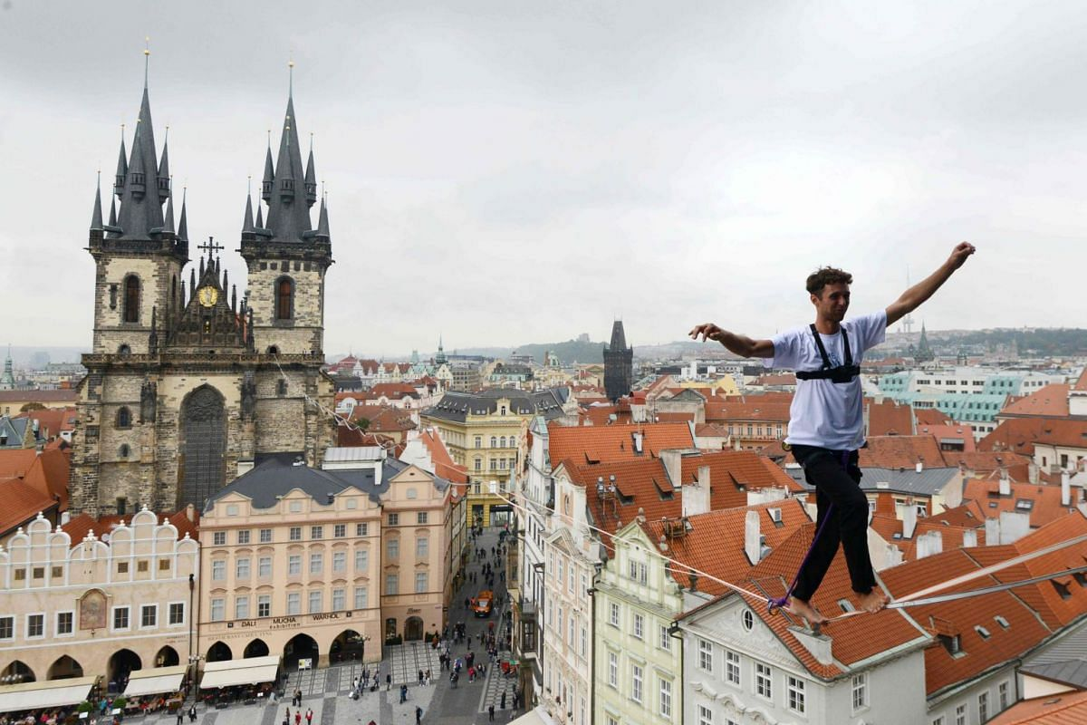 A man balances on a rope highly over the Old Town square as part of the 'Zivot na hrane' campaign supporting people diagnosed with diabetes on Sept 25, 2017 in Prague, Czech Republic. PHOTO: AFP