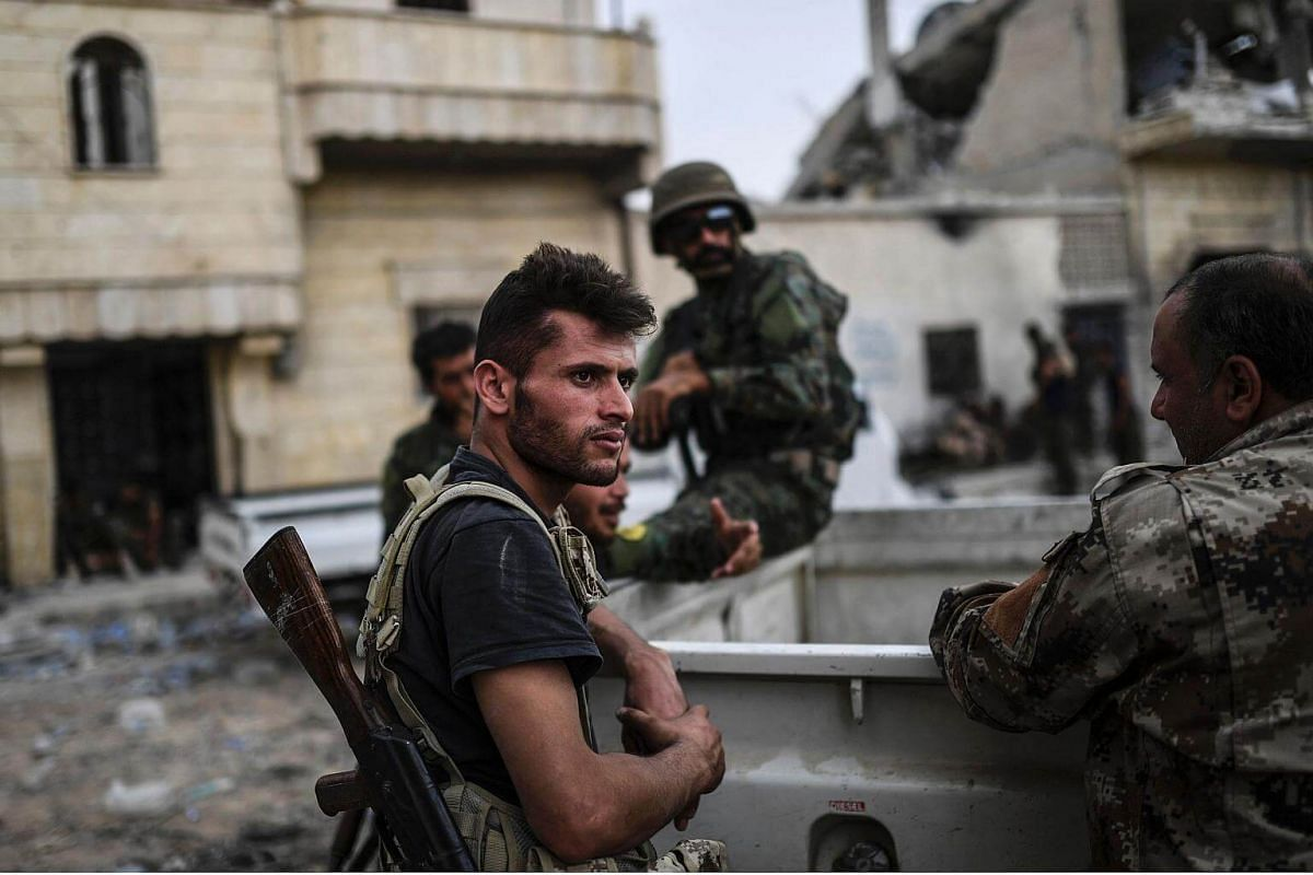 Members of the Syrian Democratic Forces hold a position on the eastern frontline of Raqa on Sept 24, 2017.