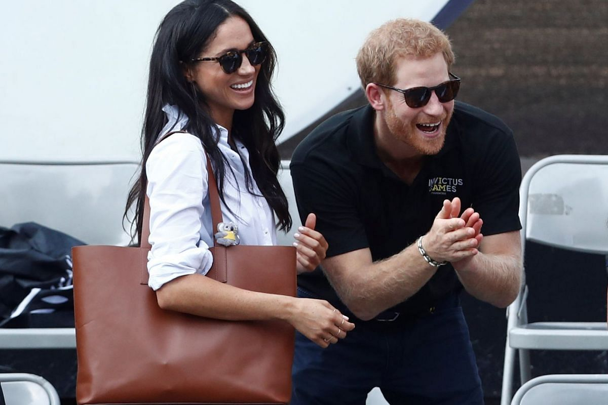 Britain's Prince Harry and his girlfriend, actress Meghan Markle, watch the wheelchair tennis event during the Invictus Games in Toronto, Ontario, Canada on Sept 25, 2017. PHOTO: REUTERS