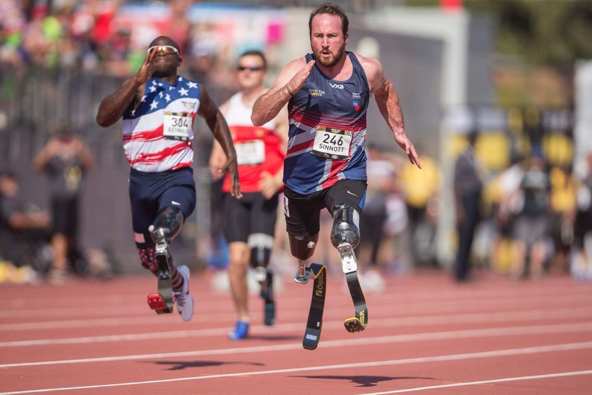 Luke Sinnott, of Britain competes in the men's IT2 100 meters at the athletics competition at the Invictus Games in Toronto, Ontario, on Sept 24, 2017. PHOTO: AFP