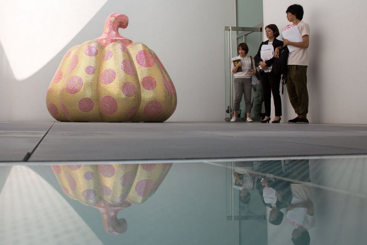 Visitors look at the Starry Pumpkin on display at the Yayoi Kusama Museum in Tokyo, Japan, on 26 Sept, 2017.