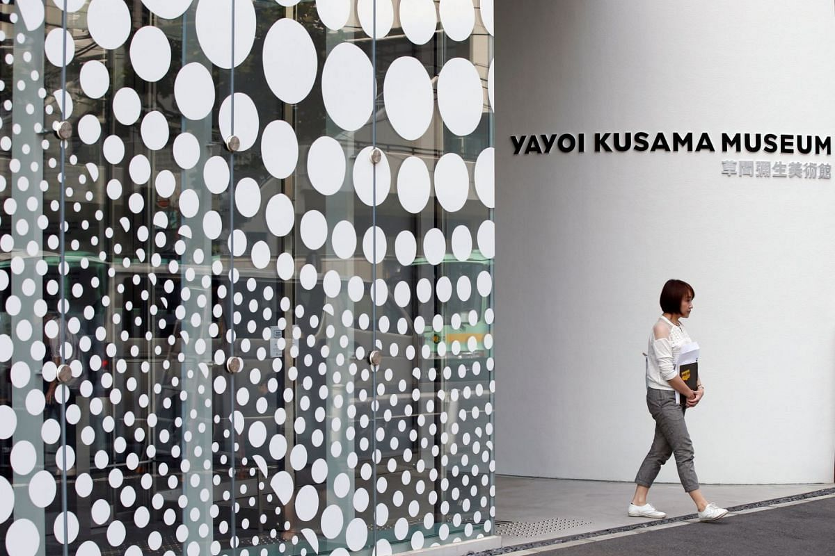 A journalist leaving the Yayoi Kusama Museum after its media preview in Tokyo, Japan, on Sept 26, 2017.