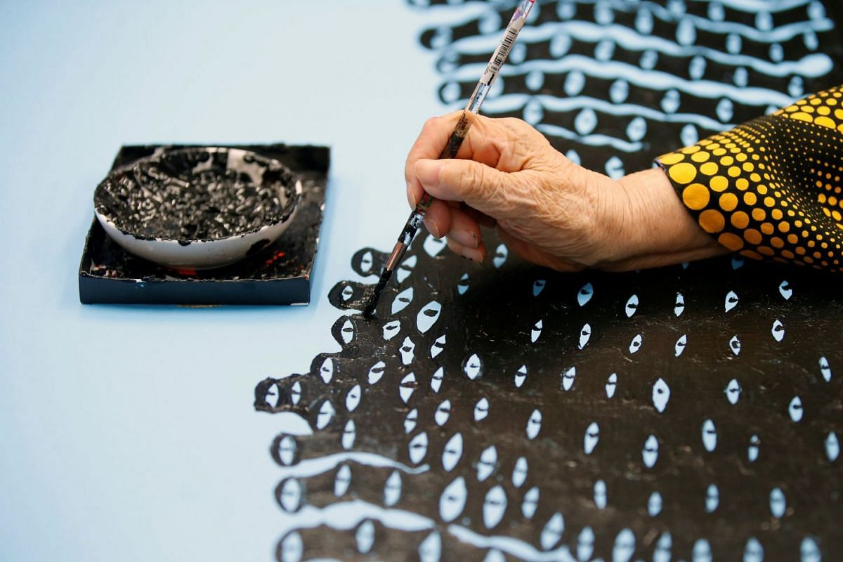 Japanese avant-garde artist Yayoi Kusama working on a creation at her studio in Tokyo, Japan, on Sept 26, 2017.