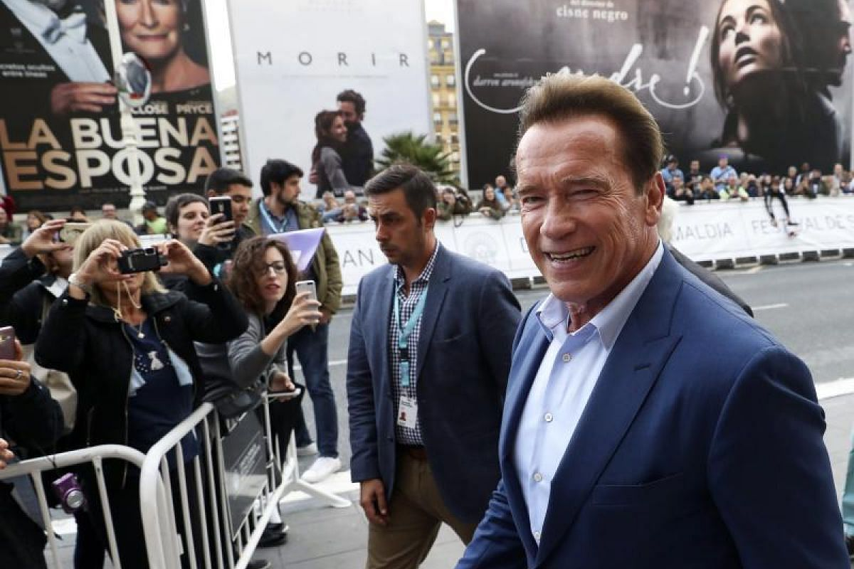 Actor and former US politician Arnold Schwarzenegger poses for the media during the premiere of the documentary Wonders Of The Sea 3D.