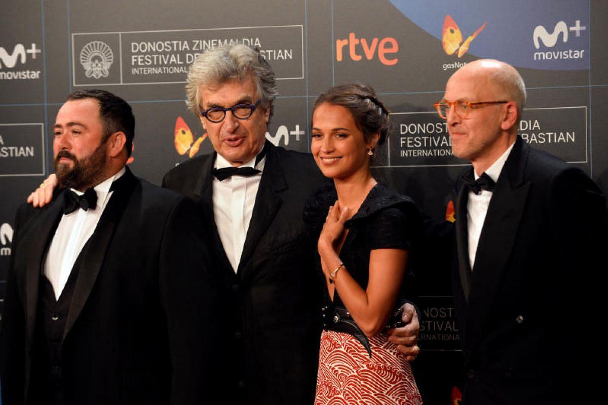 British actor Celyn Jones, German film-maker Wim Wenders, Swedish actor Alicia Vikander and British writer Jonathan Ledgard arrive at the opening gala.