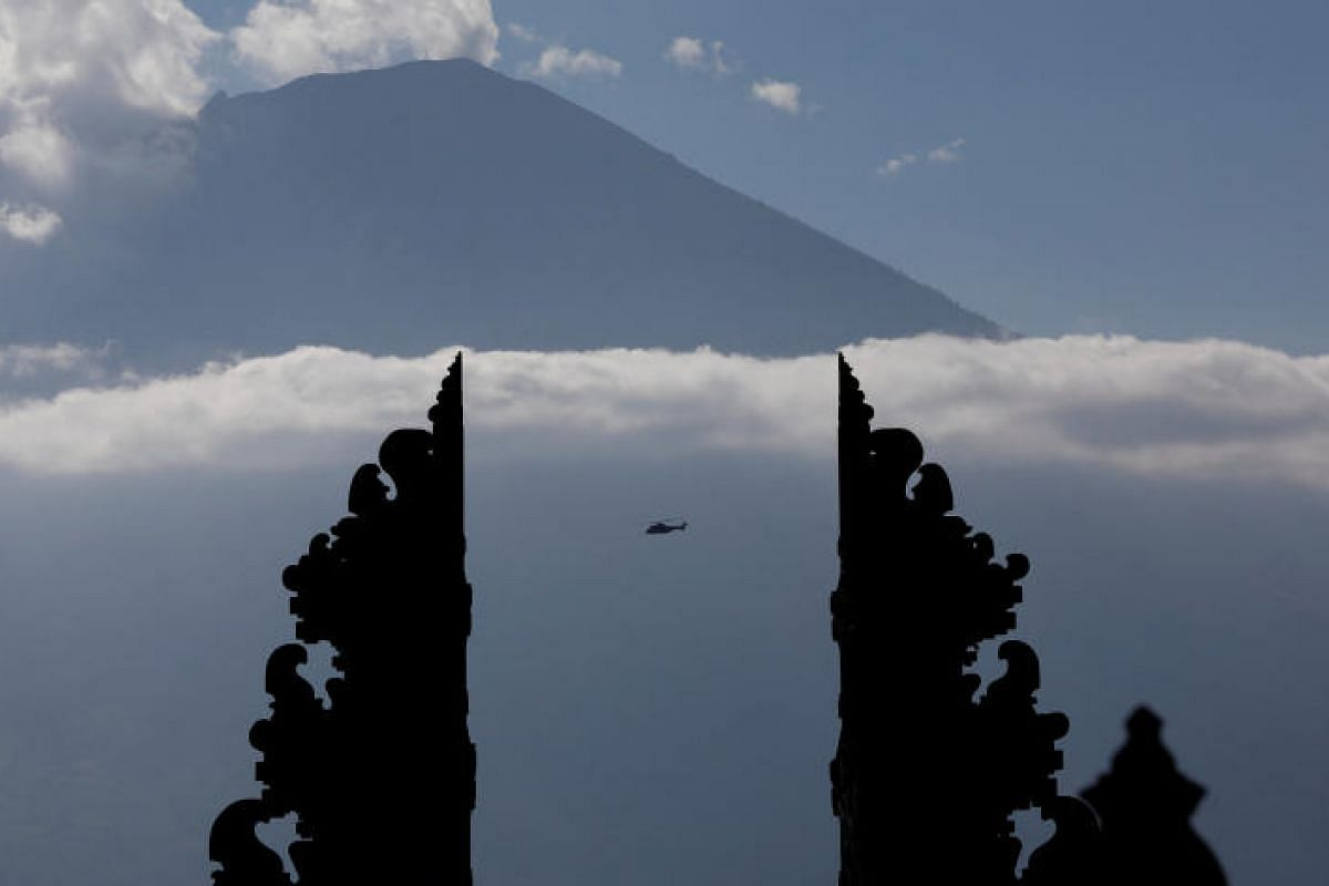 A helicopter, one of three carrying officials including President Joko Widodo,  flying near Mount Agung, from Penataran Agung Lempuyang temple in Karangasem Regency on Tuesday.