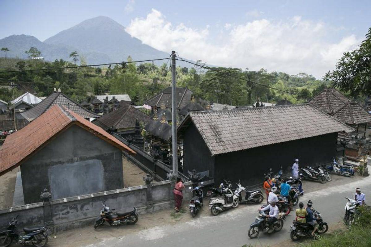 Mount Agung looming over Pemuteran village in Karangasem on Sept 27.