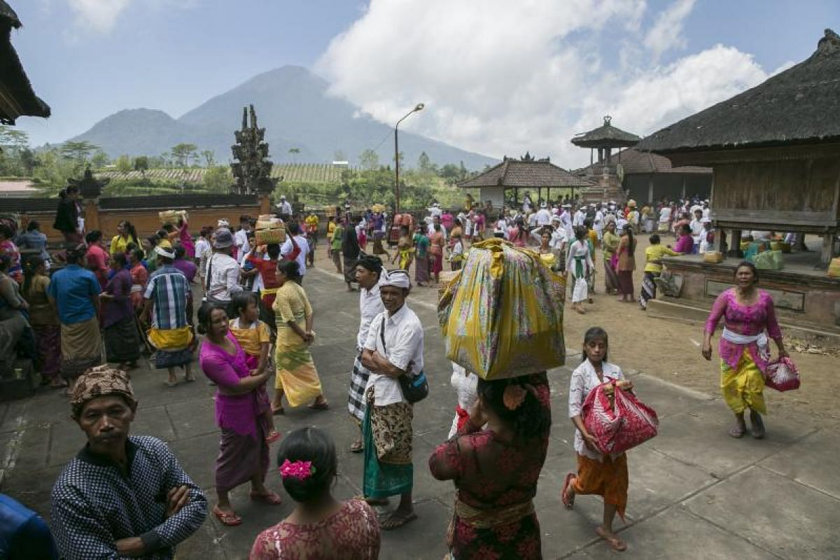 Hindus leaving after a prayer for Mount Agung at a temple in Pemuteran village on Sept 27.