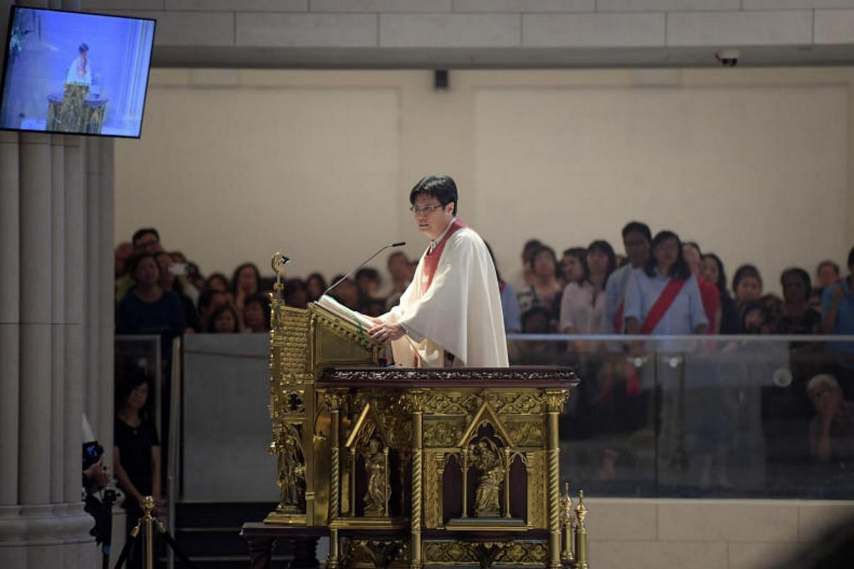 Rev Fr Peter Wee, the rector of the Novena Church, holds the first mass in the church.