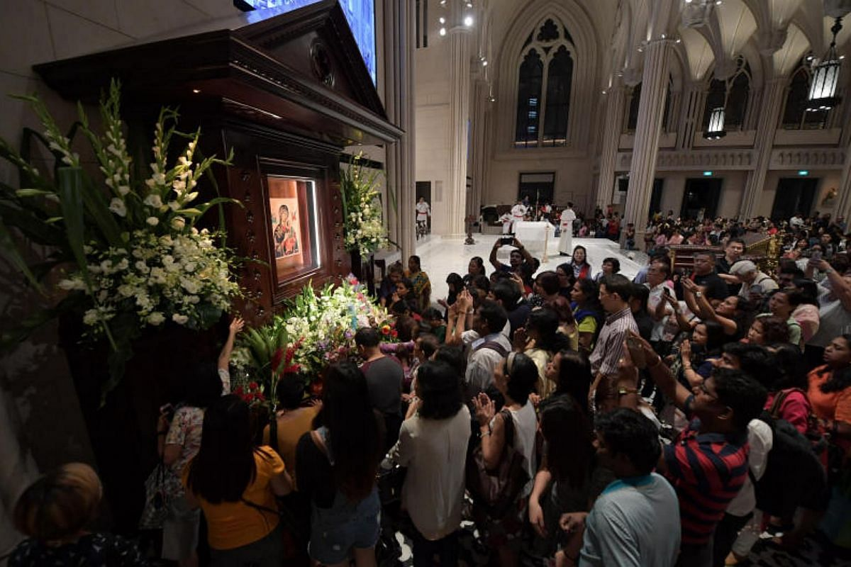 Crowds throng the shrine of Our Lady of Perpetual Help.