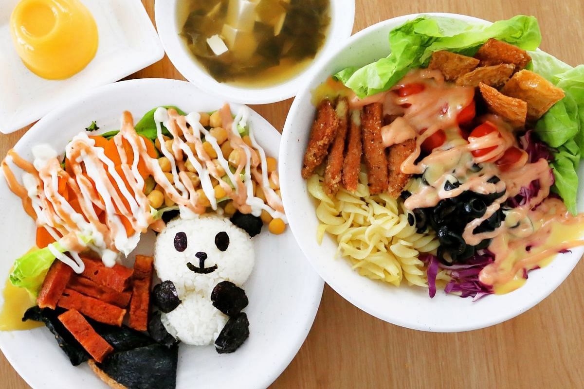 Yummy Salad House serves build-your-own salads as well as sets such as the Happy Panda Set (left), with a panda fashioned out of sushi rice.