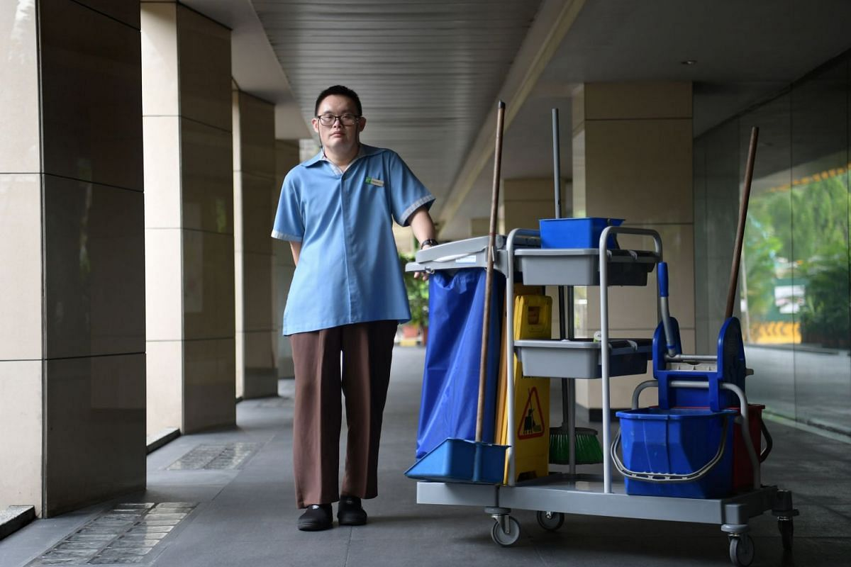 Kwang Hee (above), a cleaner at Holiday Inn Singapore Orchard City Centre hotel and who has Down syndrome