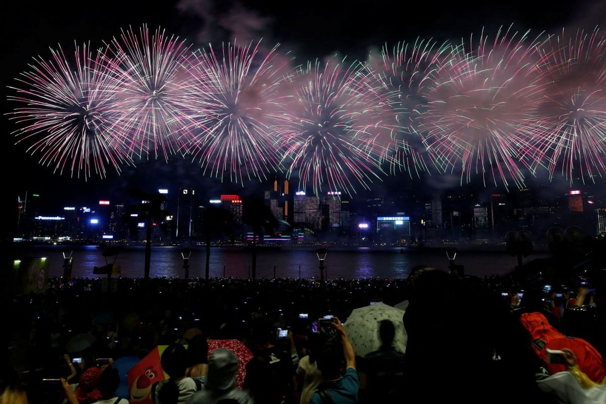 Fireworks explode over Victoria Harbour to celebrate the Chinese National Day in Hong Kong, China, October 1, 2017. PHOTO: REUTERS