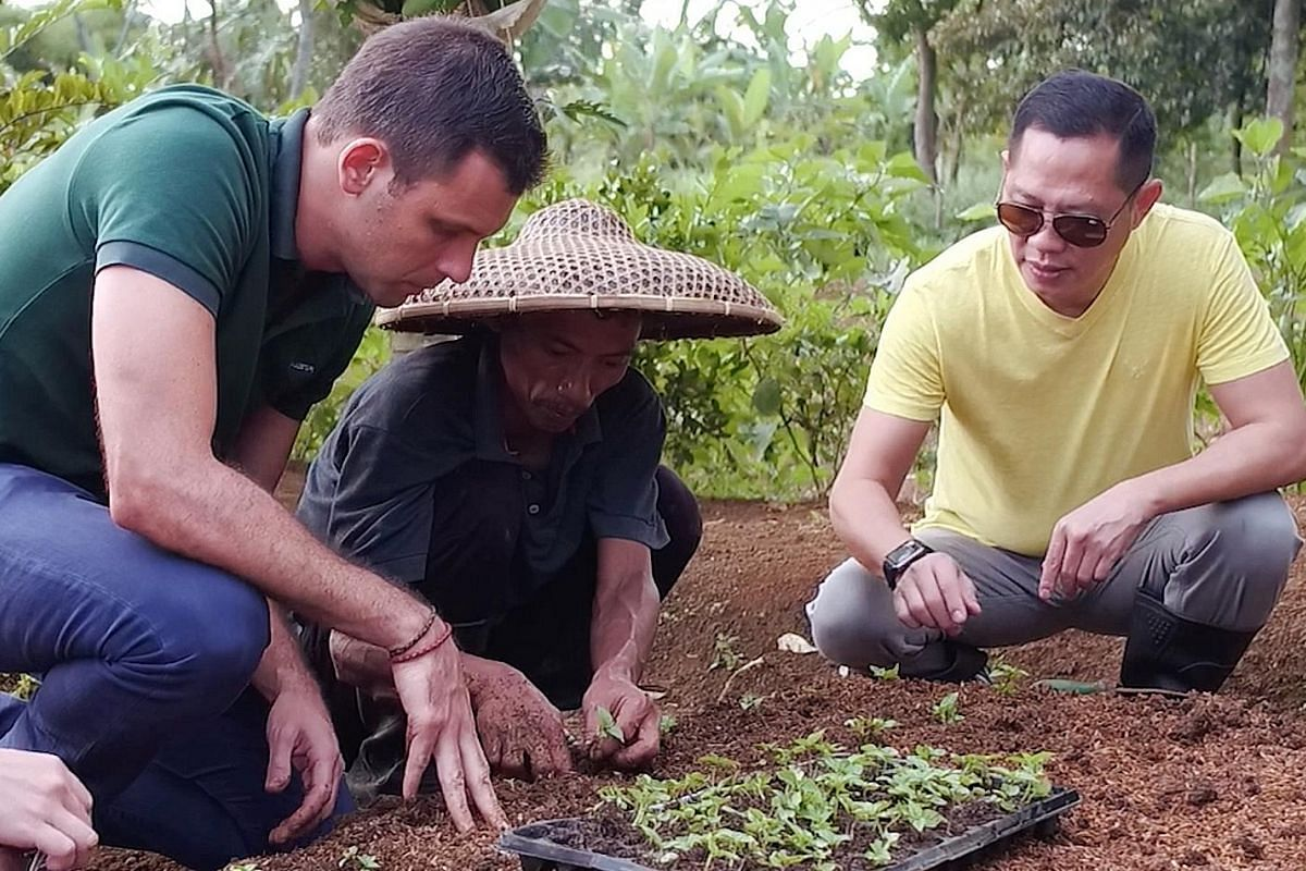Mr Adrien Desbaillets with farmer Pak Angga (right) in Indonesia.
