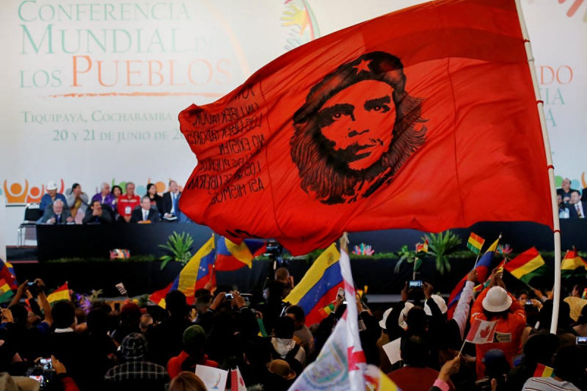 """A flag carrying the image of Ernesto """"Che"""" Guevara during the inauguration in June of the World People's Conference in Bolivia, where many still revere the revolutionary leader."""