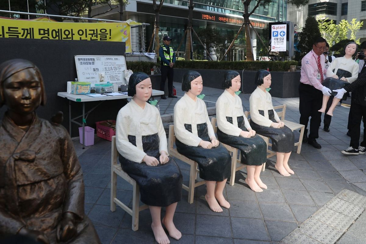 Statues symbolizing comfort women are temporarily placed in front of the Japanese Embassy prior to being transported to regional towns in Seoul, South Korea, October 02,  2017.  PHOTO: EPA-EFE