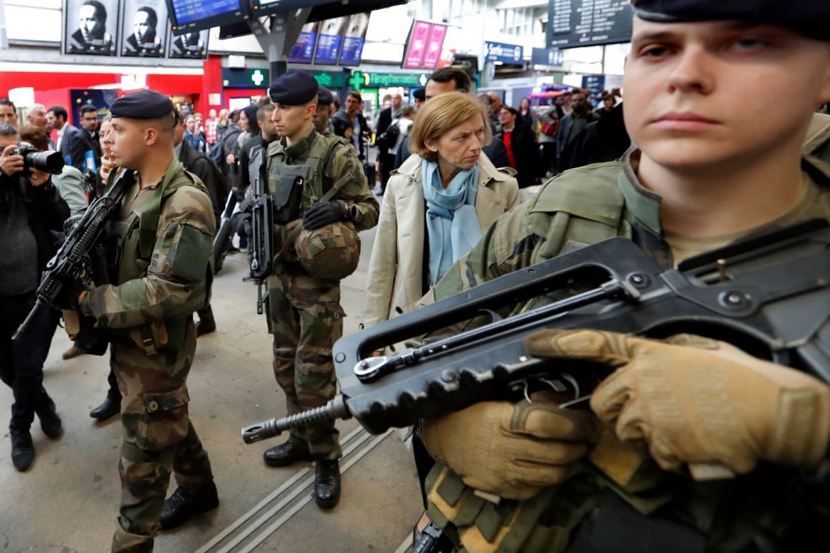 French Defence Minister Florence Parly walks with French soldiers in the Montparnasse train station in Paris, France, October 2, 2017.  PHOTO: REUTERS
