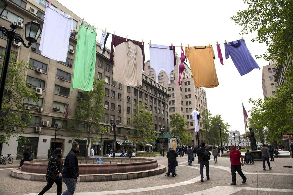 A giant clothing line hangs in public as part of the Made At Home Festival in Santiago, Chile, Oct 2, 2017.  PHOTO: AFP