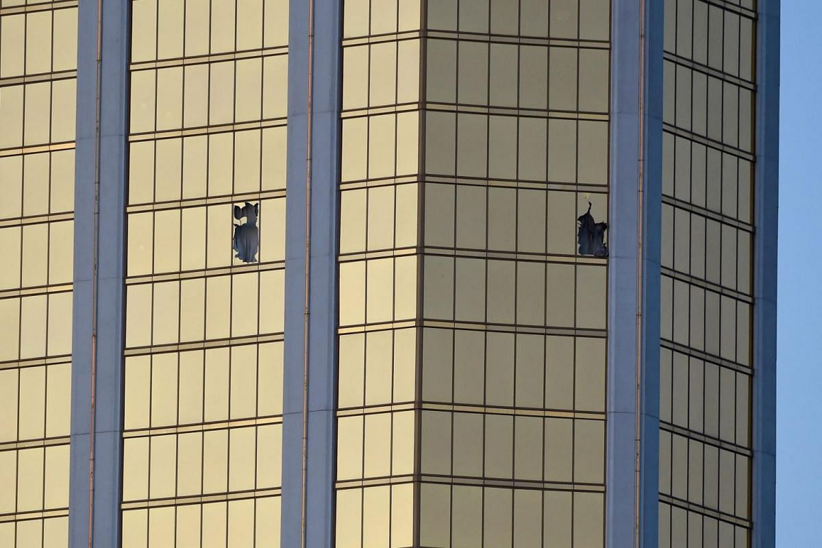 Broken windows are seen on the 32nd floor of the Mandalay Bay Resort and Casino after a lone gunman opened fired on the Route 91 Harvest country music festival in Las Vegas.