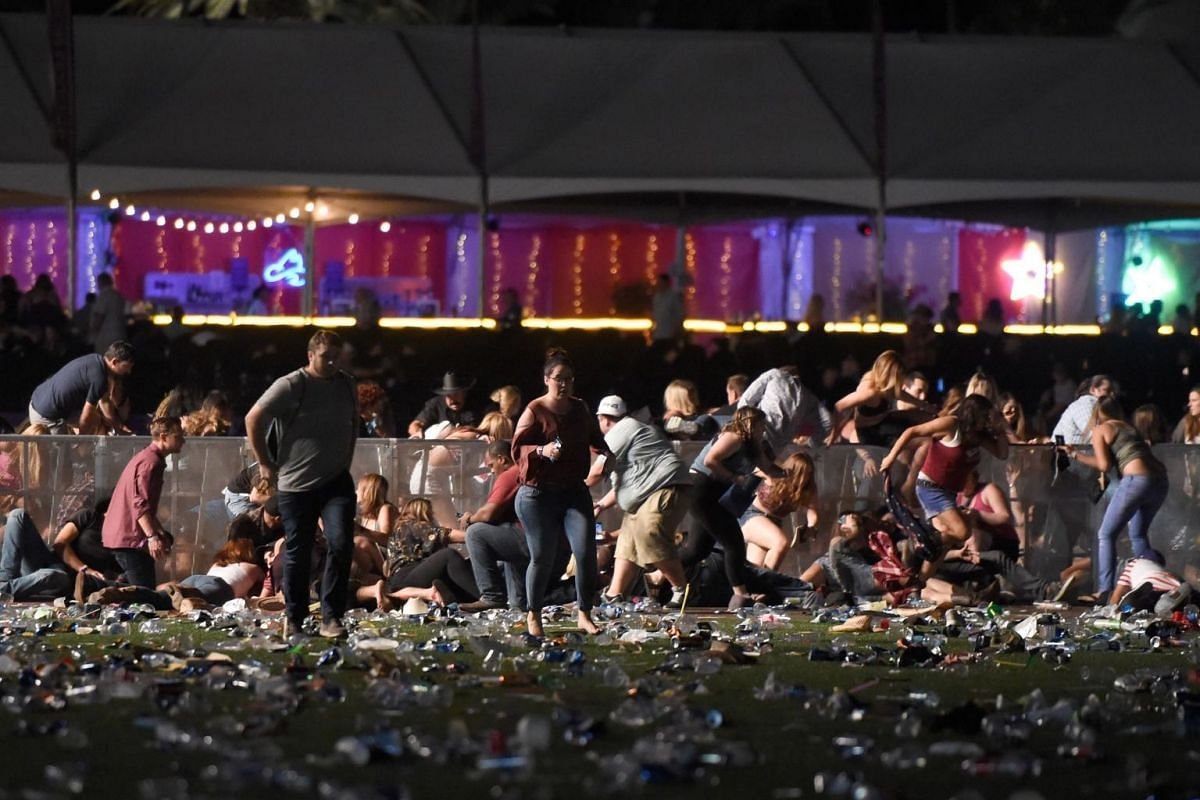 People run from the Route 91 Harvest country music festival after apparent gun fire was heard.