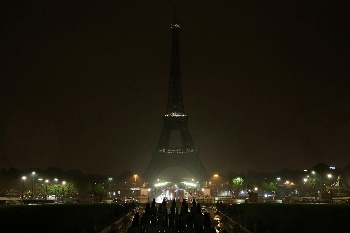 The lights of the Eiffel Tower in Paris are switched off  in tribute to the victims of the attacks in Las Vegas and Marseille, on Oct 2, 2017.