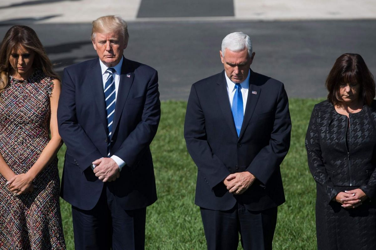 US President Donald Trump and First Lady Melania Trump along with Vice President Mike Pence and his wife Karen Pence take part in a moment of silence for the victims of the Las Vegas shootings, on the South Lawn of the White House.