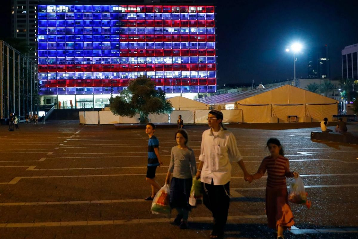 Tel Aviv city hall lit up in the colours of the American national flag to honour the victims of the attack in Las Vegas, at the Rabin Square in Tel Aviv.