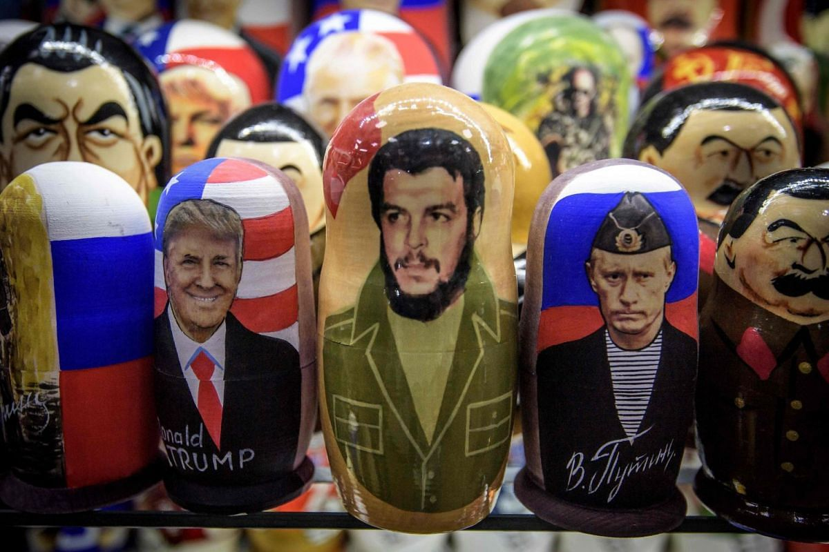 Traditiional Russian nesting dolls depicting, from left, US President Donald Trump, Cuban leader Ernesto Che Guevara and Russian President Vladimir Putin in a souvenir shop in Moscow, Russia, Oct 2, 2017.