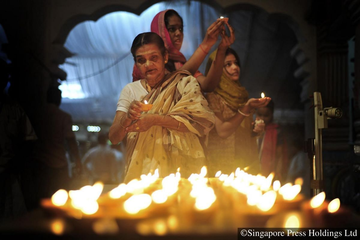 2008: Devotees placing lamps at an altar at the Sri Srinivasa Perumal Temple on the eve of Deepavali.