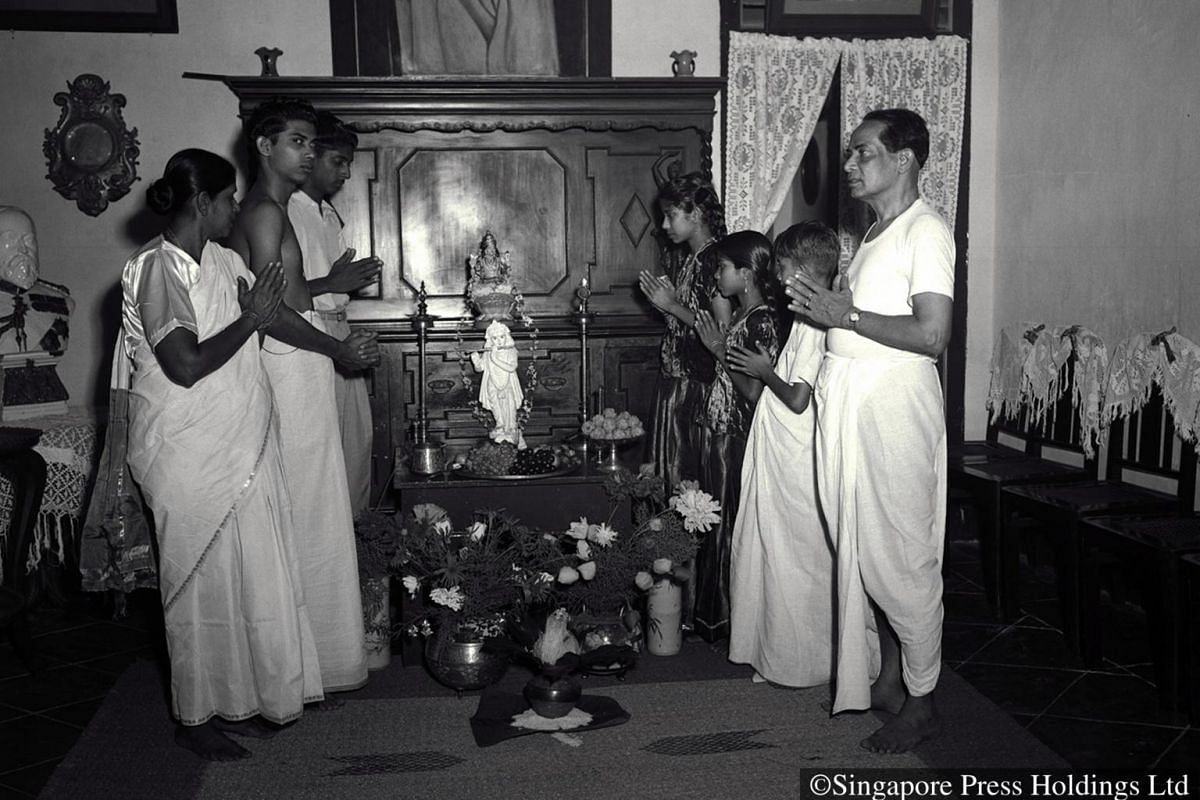 1951: A prayer ceremony at home is a must for Hindus on Deepavali morning.
