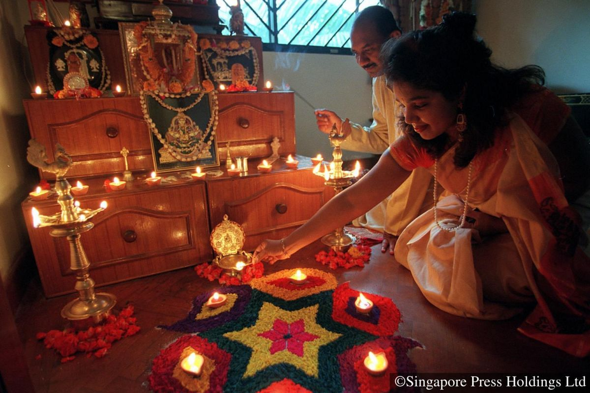 1999: Prayers performed before family shrine are part of the morning rituals on Deepavali.
