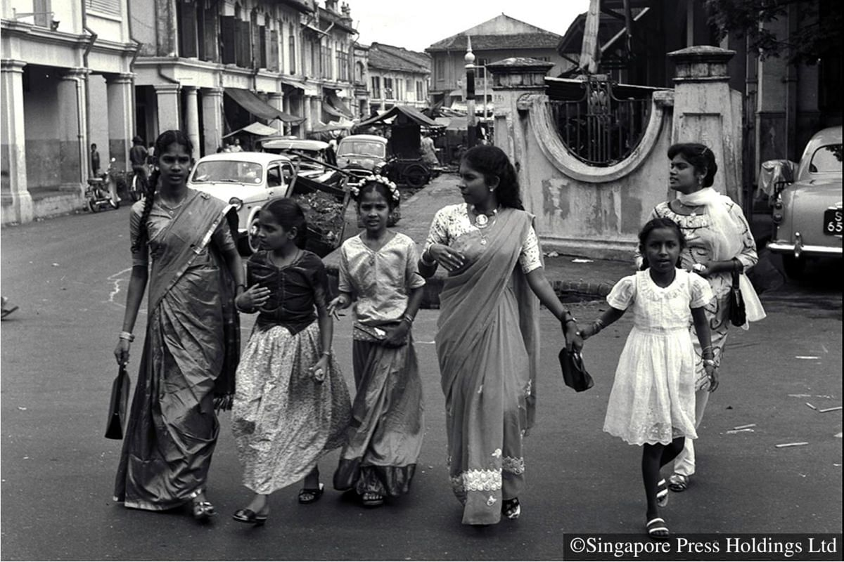 1962: A family all dressed up for Deepavali celebrations. The day is rounded up by visits to the homes of friends and relatives.