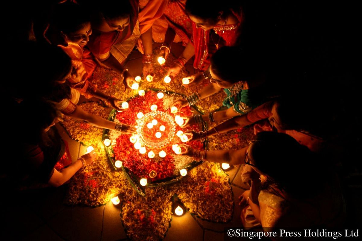 2008: Lamps are placed on a beautiful rangoli made of flowers petals on Deepavali night.