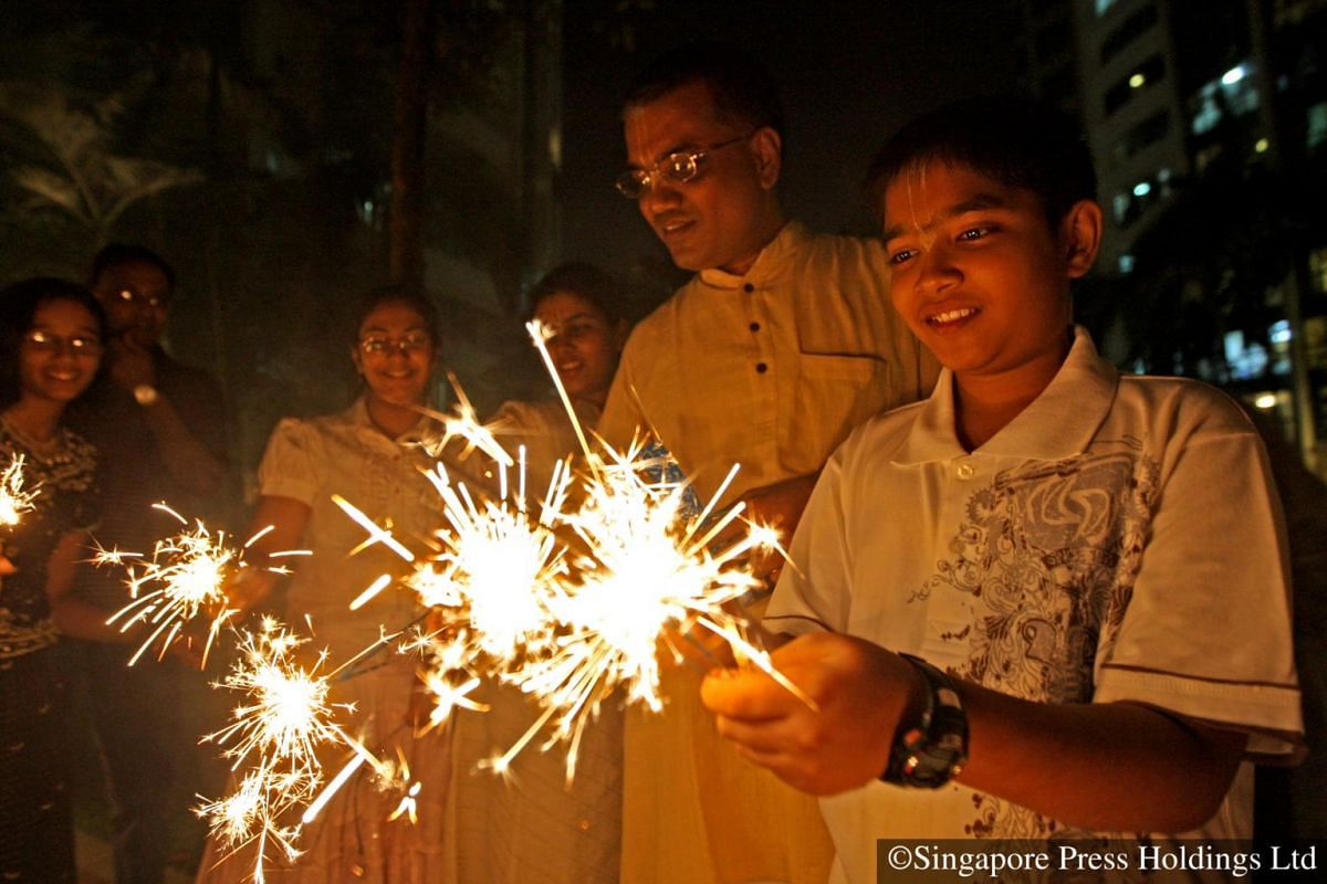 2008: Lighting up sparkles are a common part of Deepavali to drive away the darkness and ward off evil from one's surroundings.