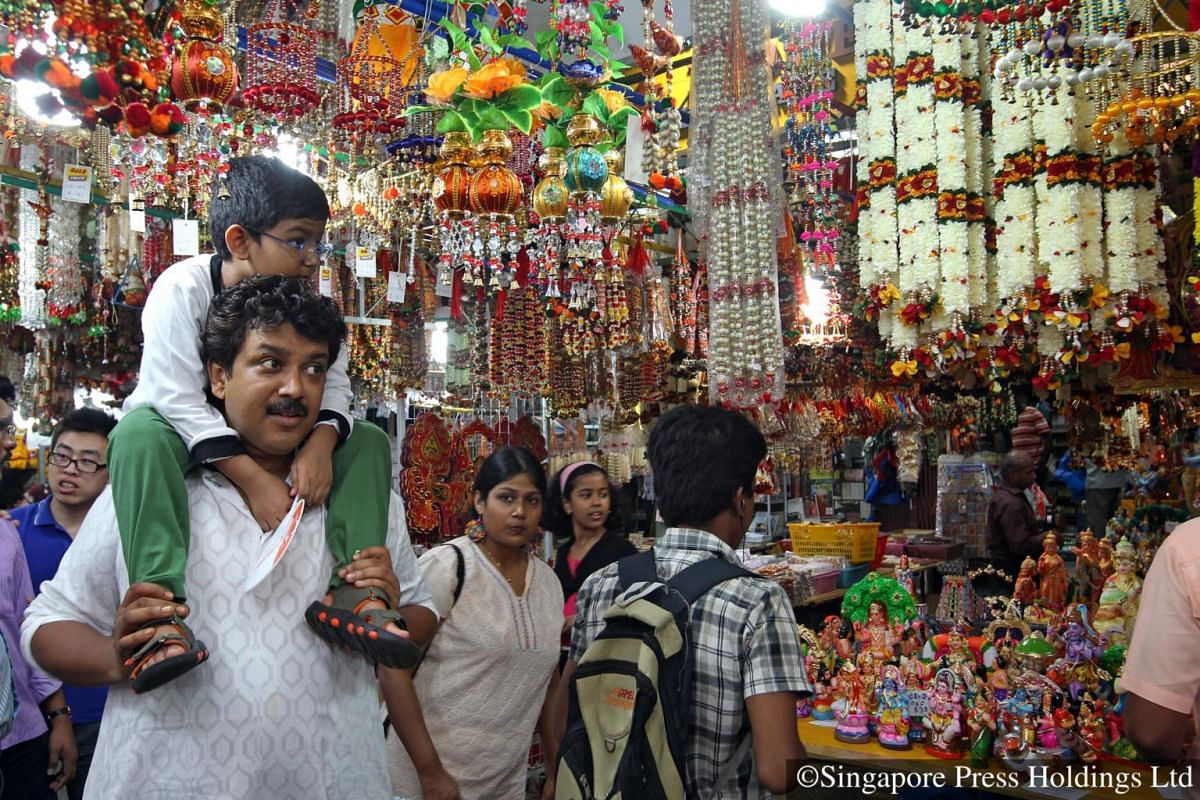 2012: Shoppers at the Deepavali bazaar along Campbell Lane. A bustling street full of shops selling indian ethnic clothes, ornamental decorations and greeting cards.