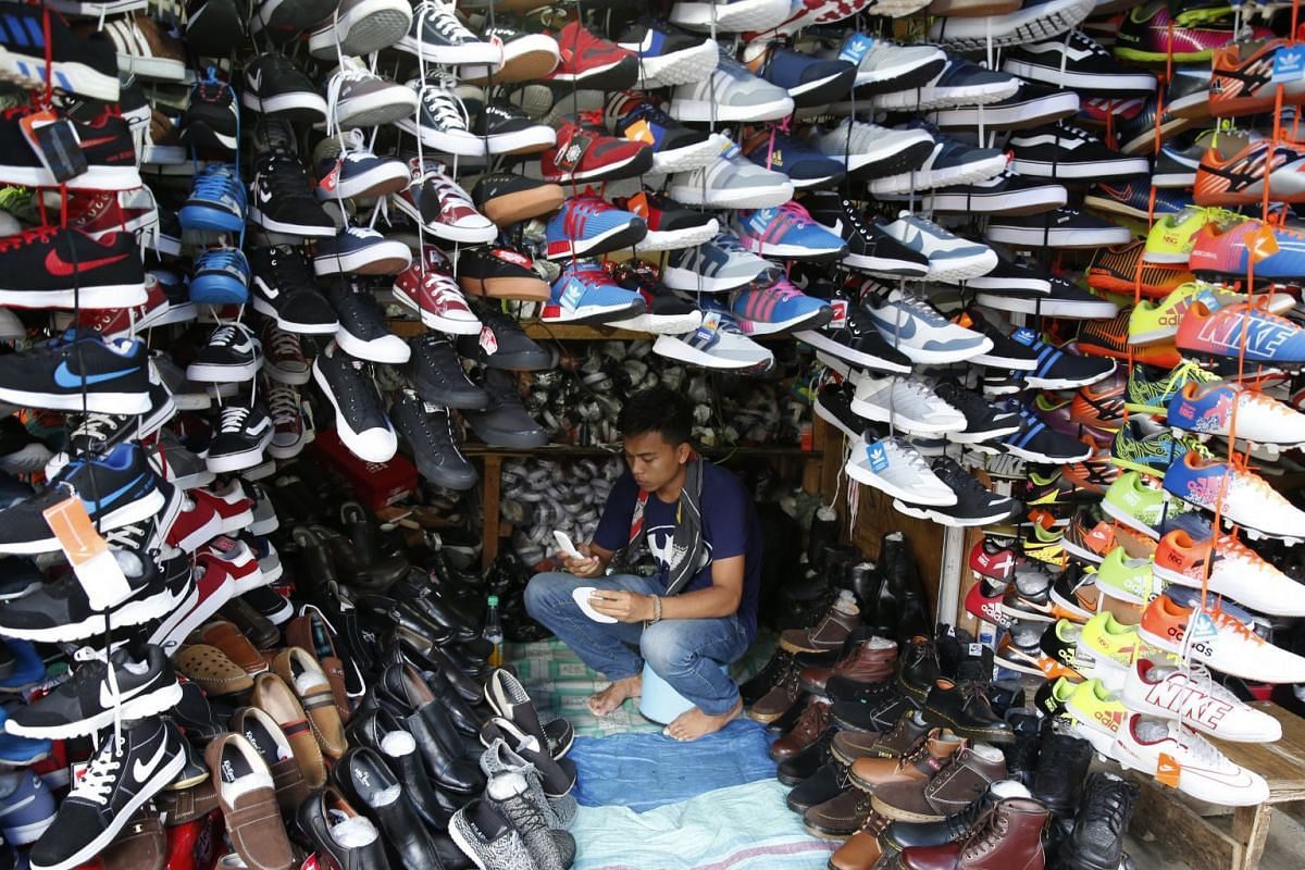 A shoe vendor waits for customers in Bogor, Indonesia, Oct 4 , 2017. PHOTO: EPA-EFE